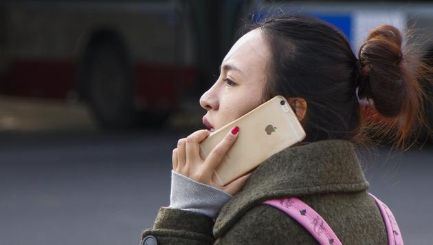 Apple und Co. in China von Einkaufsliste verbannt (Bild: APA/EPA/ROLEX DELA PENA)