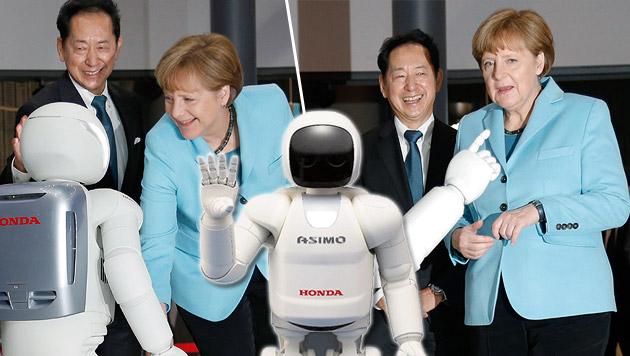 Roboter verweigerte Angela Merkel den Händedruck (Bild: AP)