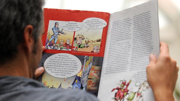 """Im Wahlkampf 2010 erdachte die FPÖ einen Comic mit Heinz-Christian Strache als """"HC Man"""". (Bild: AP/HELMUT FOHRINGER)"""