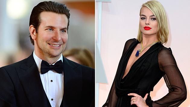 Bradley Cooper soll sich Margot Robbie geangelt haben. (Bild: APA/EPA/PAUL BUCK, APA/EPA/MIKE NELSON)