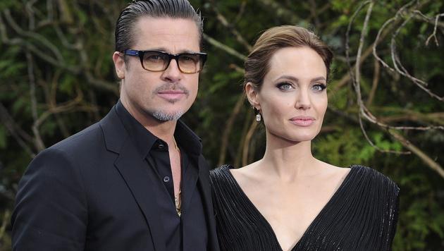 Brad Pitt und Angelina Jolie verbringen lieber Zeit mit ihren Kids statt mit Twitter und Co. (Bild: APA/EPA/FACUNDO ARRIZABALAGA)