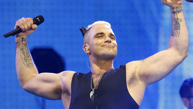 Robbie Williams (Bild: APA/EPA/ALBERTO MARTIN)