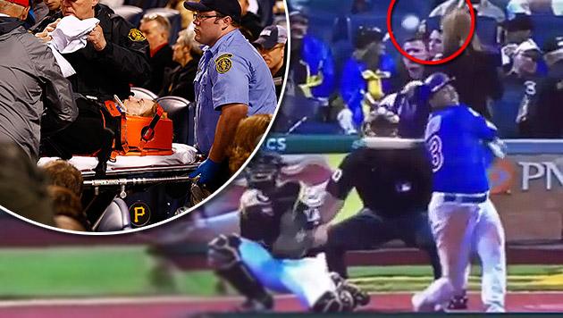 Video: Zuschauerin von Baseball am Kopf getroffen (Bild: AFP, YouTube.com, krone.at-Grafik)