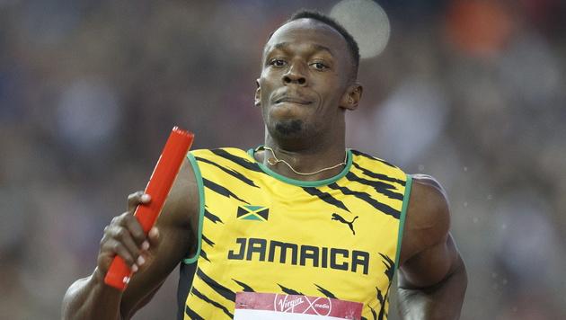 Staffel-WM: Bolt beißt mit Jamaika gegen USA ab (Bild: APA/EPA/STR)