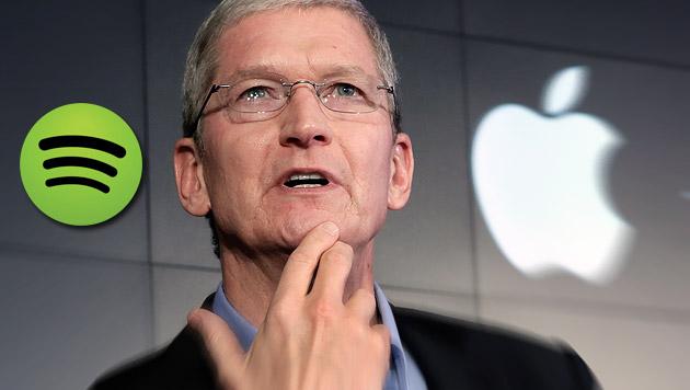 Apple bedrängt Spotify mit schmutzigen Tricks (Bild: AP, spotify.com)
