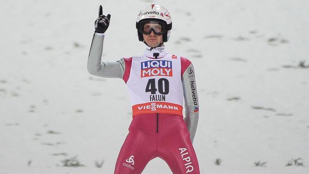 Simon Ammann setzt seine Karriere fort (Bild: APA/BARBARA GINDL)