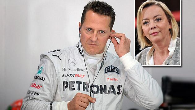 Michael Schumacher und seine Sprecherin Sabine Kehm (Bild: APA/EPA/FRANCK ROBICHON,  APA/EPA/PAUL ZINKEN)