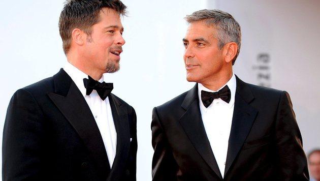 Brad Pitt und George Clooney sind keine besten Freunde mehr. (Bild: CLAUDIO ONORATI/EPA/picturedesk.com)