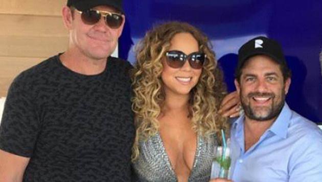 Mariah Carey mit James Packer (links) und Brett Ratner, der die beiden verkuppelt haben soll. (Bild: Viennareport)