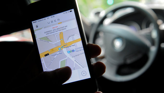 Fahrdienst Uber wirft in Frankreich das Handtuch (Bild: APA/dpa/Britta Pedersen)