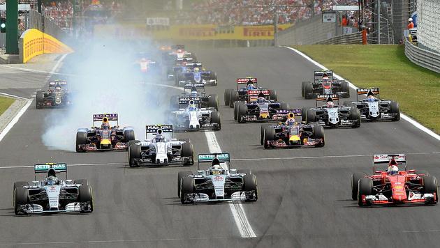 Vettel gewinnt verrückten Grand Prix von Ungarn (Bild: APA/EPA/TAMAS KOVACS)