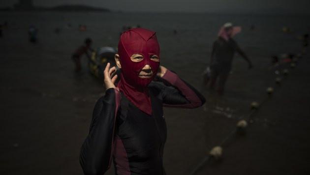 """""""Facekinis"""" sind der letzte Schrei in China (Bild: AFP)"""