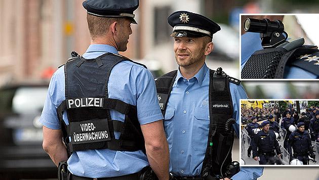 Körperkameras für die Polizei: Testlauf ab 2016 (Bild: APA/dpa/Boris Roessler, APA/HERBERT PFARRHOFER)
