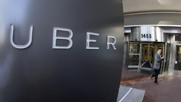 TomTom kündigt Kooperation mit Fahrdienst Uber an (Bild: AP)
