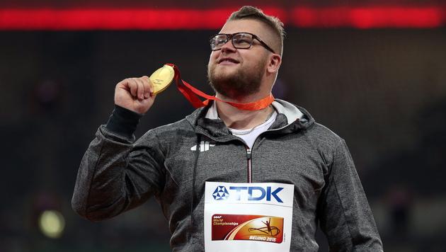 """Weltmeister """"bezahlt"""" Taxifahrt mit Goldmedaille (Bild: APA/EPA/WU HONG)"""