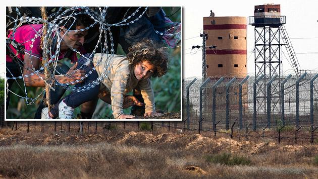 Flüchtlinge schlüpfen unter dem Zaun zwischen Serbien und Ungarn durch; Israels Hightech-Barriere (Bild: AP, APA/EPA/ABIR SULTAN)