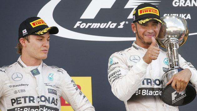 Hamilton triumphiert beim GP von Japan vor Rosberg (Bild: APA/EPA/DIEGO AZUBEL)