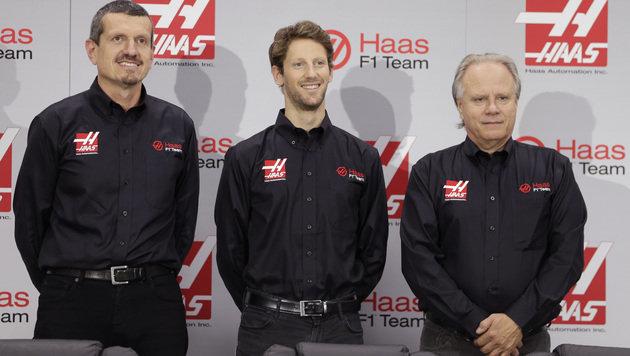 Teamchef Steiner, Nummer-1-Fahrer Grosjean und Teambesitzer Haas (Bild: AP)
