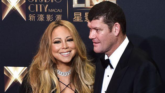 Sängerin Mariah Carey lächelt bei der Casino-Eröffnung auf Macau für die Kameras. (Bild: APA/AFP/PHILIPPE LOPEZ)
