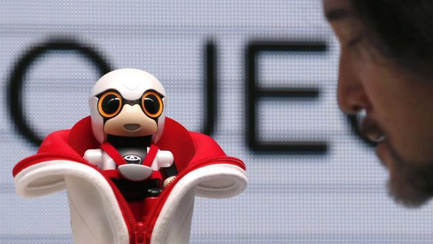 Kirobo Mini: Robo-Beifahrer für den Getränkehalter (Bild: AP)