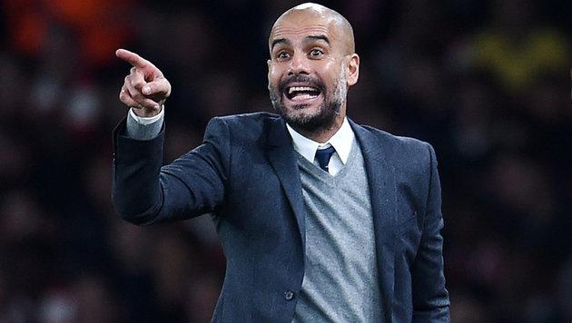 Pep Guardiola bleibt Trainer bei Bayern München (Bild: APA/EPA/ANDY RAIN)