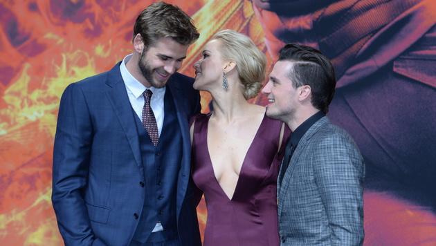 Jennifer Lawrence mit Liam Hemsworth und Josh Hutcherson (Bild: APA/EPA/BRITTA PEDERSEN)