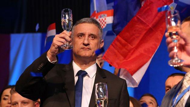 HDZ-Parteichef Tomislav Karamarko ist nicht mehr nach Feiern zumute. (Bild: APA/AFP/STR)