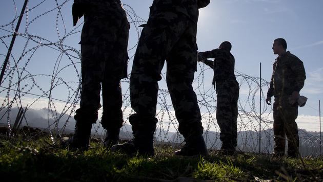 Ein Zaun an der slowenisch-österreichischen Grenze (Bild: AP)