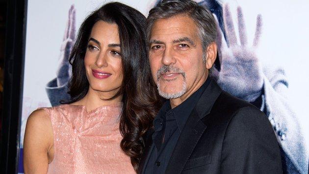 Amal und Georg Clooney (Bild: AP)