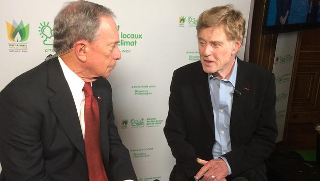 Robert Redford und der ehemalige New Yorker Bürgermeister Michael Bloomberg (li.) (Bild: AP)
