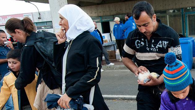 Flüchtlinge kosten den Staat 2,7 Milliarden Euro (Bild: AP)