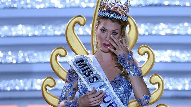 """Da kann es die neue """"Miss World"""" ihr Glück noch gar nicht fassen. (Bild: AFP)"""