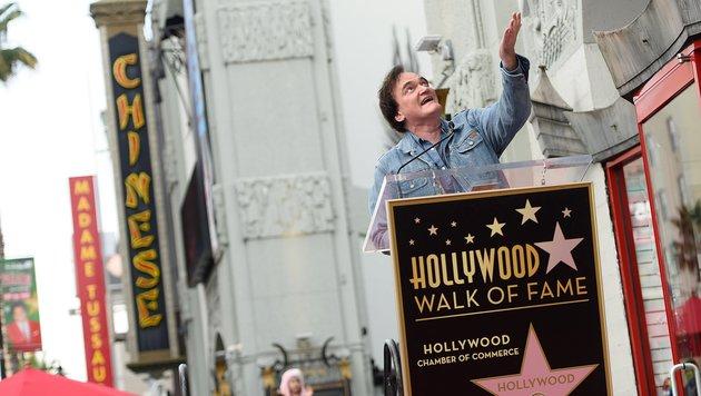 Der Star-Regisseur strahlte bei der Enthüllung der 2569. Plakette. (Bild: AFP/Angela Weiss)