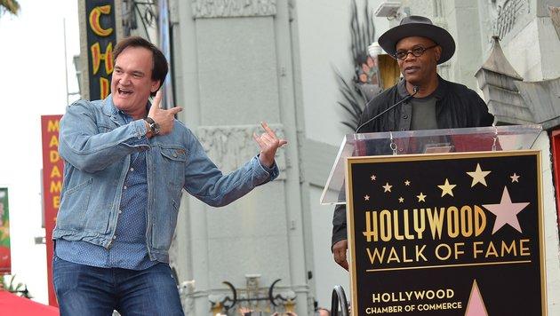Zur Präsentation des Sterns brachte er Samuel L. Jackson mit, der seinen 67. Geburtstag feierte. (Bild: AFP/Angela Weiss)