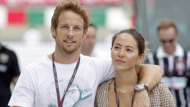 Jenson Button und Jessica Michibata (Bild: EPA)