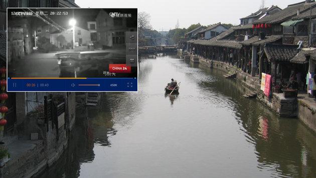 Weil sie in ihr Handy vertieft war, ertrank eine Frau in Wenzhou im örtlichen Oujiang-Fluss. (Bild: flickr.com/Ken Marshall, Screenshot cntv.cn)