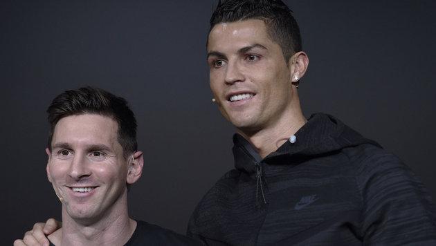 Lionel Messi (links) und Cristiano Ronaldo (rechts) (Bild: AP)