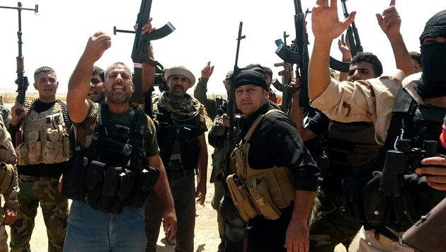 Kurdische Kämpfer (Bild: APA/EPA/STR)