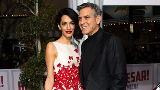 Amal und George Clooney (Bild: APA/AFP/VALERIE MACON)
