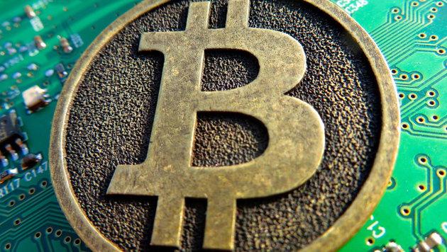 Bitcoins bekommt man ab sofort bei der Post (Bild: flickr.com/BTC Keychain)