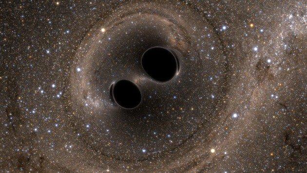 Künstlerische Illustration: Das Verschmelzen zweier Schwarzer Löcher (Bild: Caltech/MIT/LIGO)