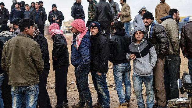 """""""Eine Million Syrer fl�chtet heuer nach Europa"""" (Bild: APA/AFP/BULENT KILIC)"""