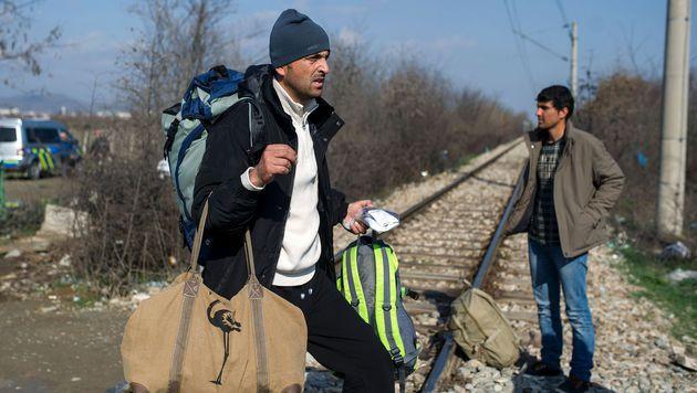 Flüchtlinge in Mazedonien (Bild: APA/AFP/ROBERT ATANASOVSKI)