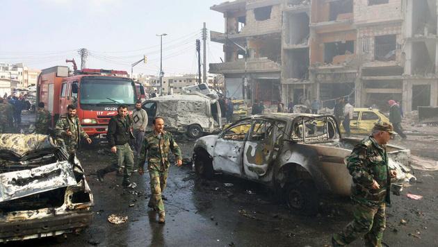 Über 120 Bomben-Tote in Damaskus und Homs (Bild: AP)