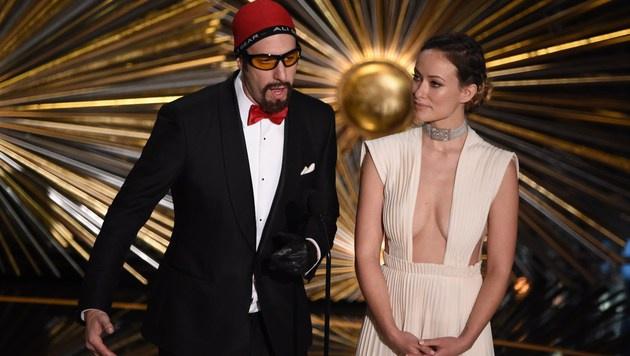 Sacha Baron Cohen und Olivia Wilde (Bild: APA/AFP/MARK RALSTON)
