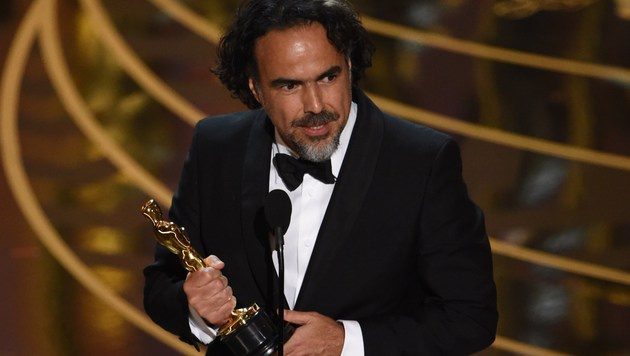 Alejandro Gonzalez Inarritu wird für die beste Regie ausgezeichnet. (Bild: APA/AFP/MARK RALSTON)