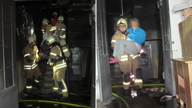 Die Helfer bei der Rettung der Opfer - eines von ihnen musste aus dem Gebäude getragen werden (Bild: Berufsfeuerwehr Graz)