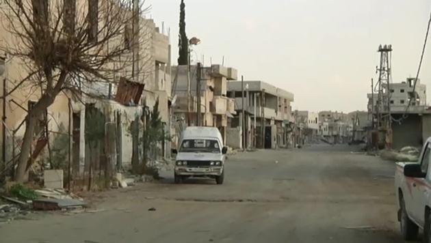 Syrien: Bewohner kehren in zerstörte Häuser zurück (Bild: Screenshot/RT RUPTLY)