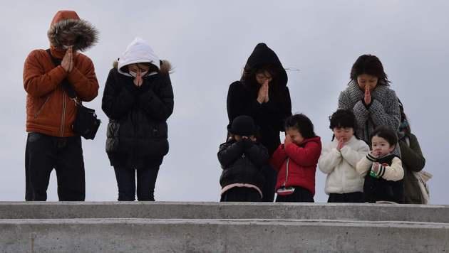 Schweigeminute für die 18.500 Toten von Fukushima (Bild: AFP or licensors)