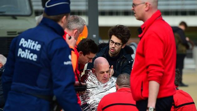 Ein Opfer am Zaventem-Flughafen (Bild: APA/AFP/EMMANUEL DUNAND)